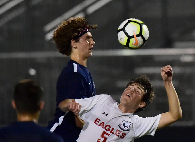 Chambersburg's Aaron Maynard (15) goes over CV's Dominik Nitecki (5) to head the ball. Chambersburg hosted Cumberland Valley in PIAA soccer on Thursday, Oct. 4, 2018, but dropped a 2-1 match in double overtime.