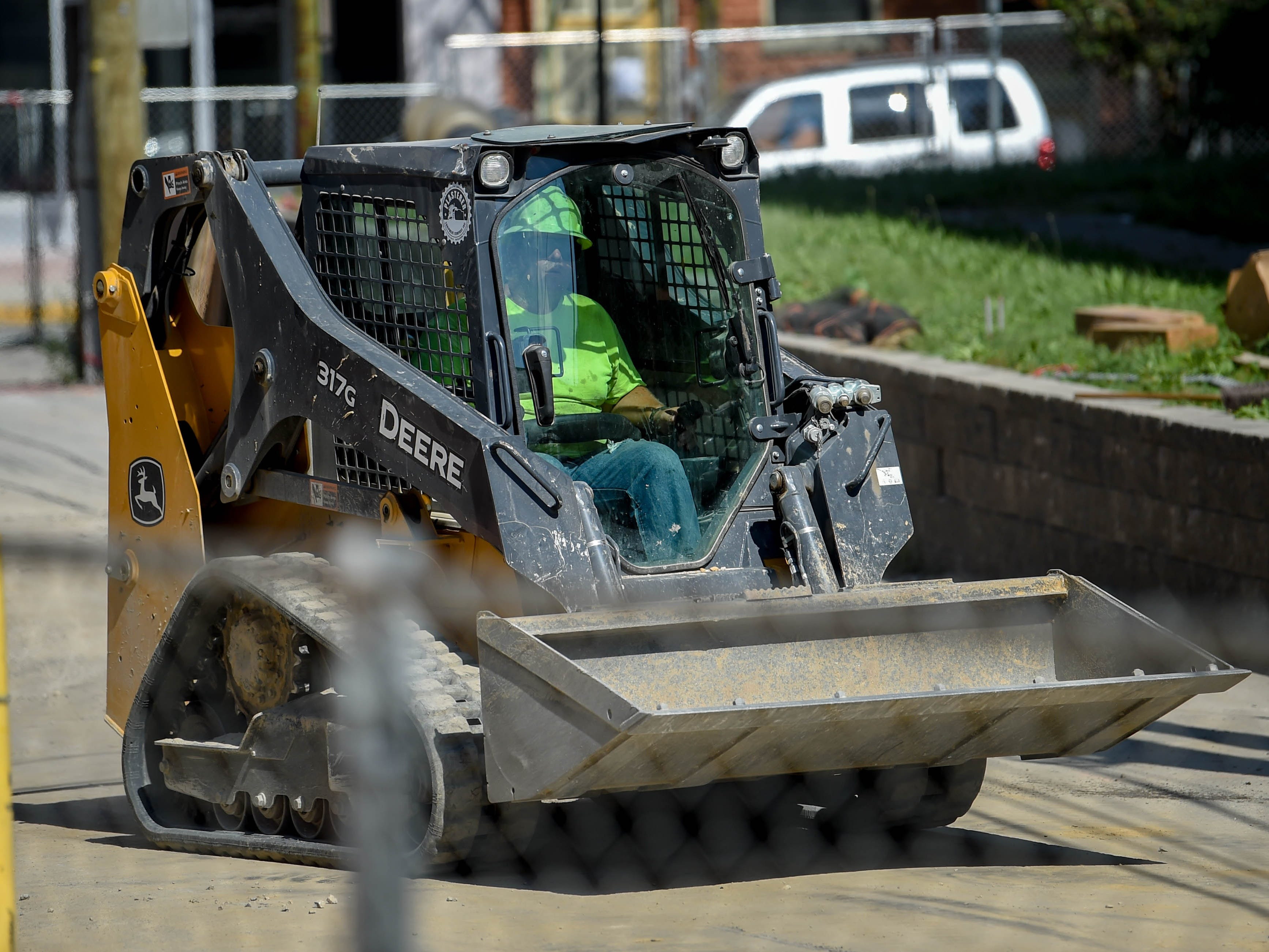A construction worker makes his way to the next pile of debris at the Yorktowne Hotel on October 4, 2018.