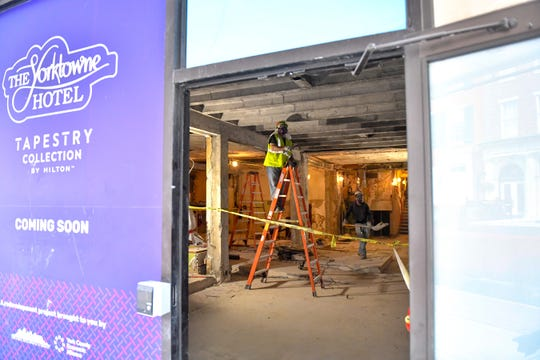 Passersby can catch a glimpse of the construction action at the Yorktowne Hotel.