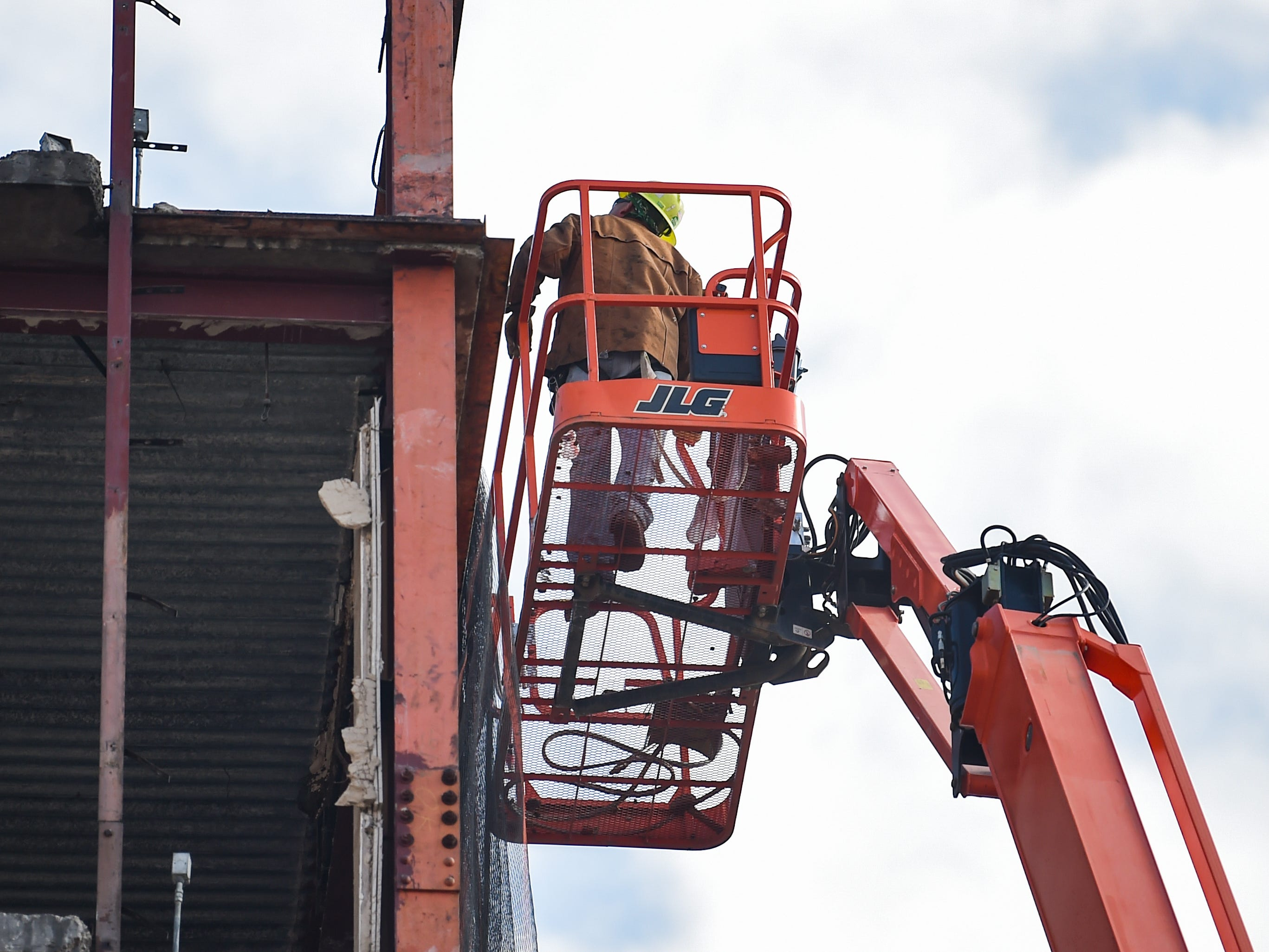 Construction workers must use blow torches to cut beams too high for the trackhoe at the Yorktowne Hotel on October 4, 2018.