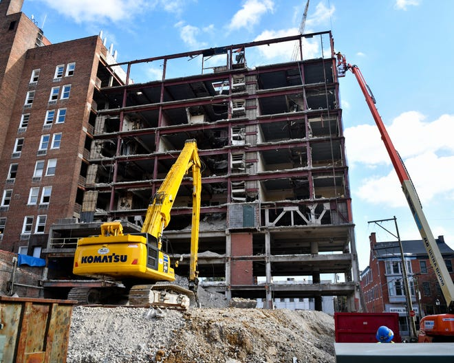 Each day, more heavy machinery is used to bring down significant parts of the Yorktowne Hotel.