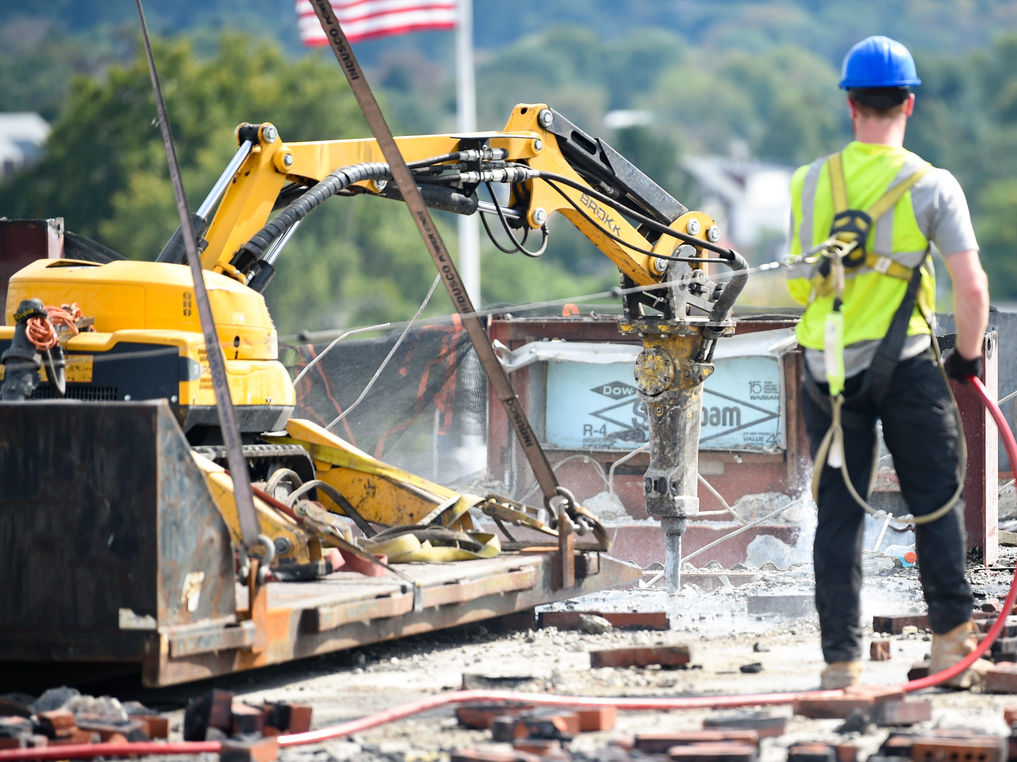 The Brokk 110, a demolition robot, is used to tear apart the eighth floor because it's too high for the trackhoe to reach at the Yorktowne Hotel on October 4, 2018.