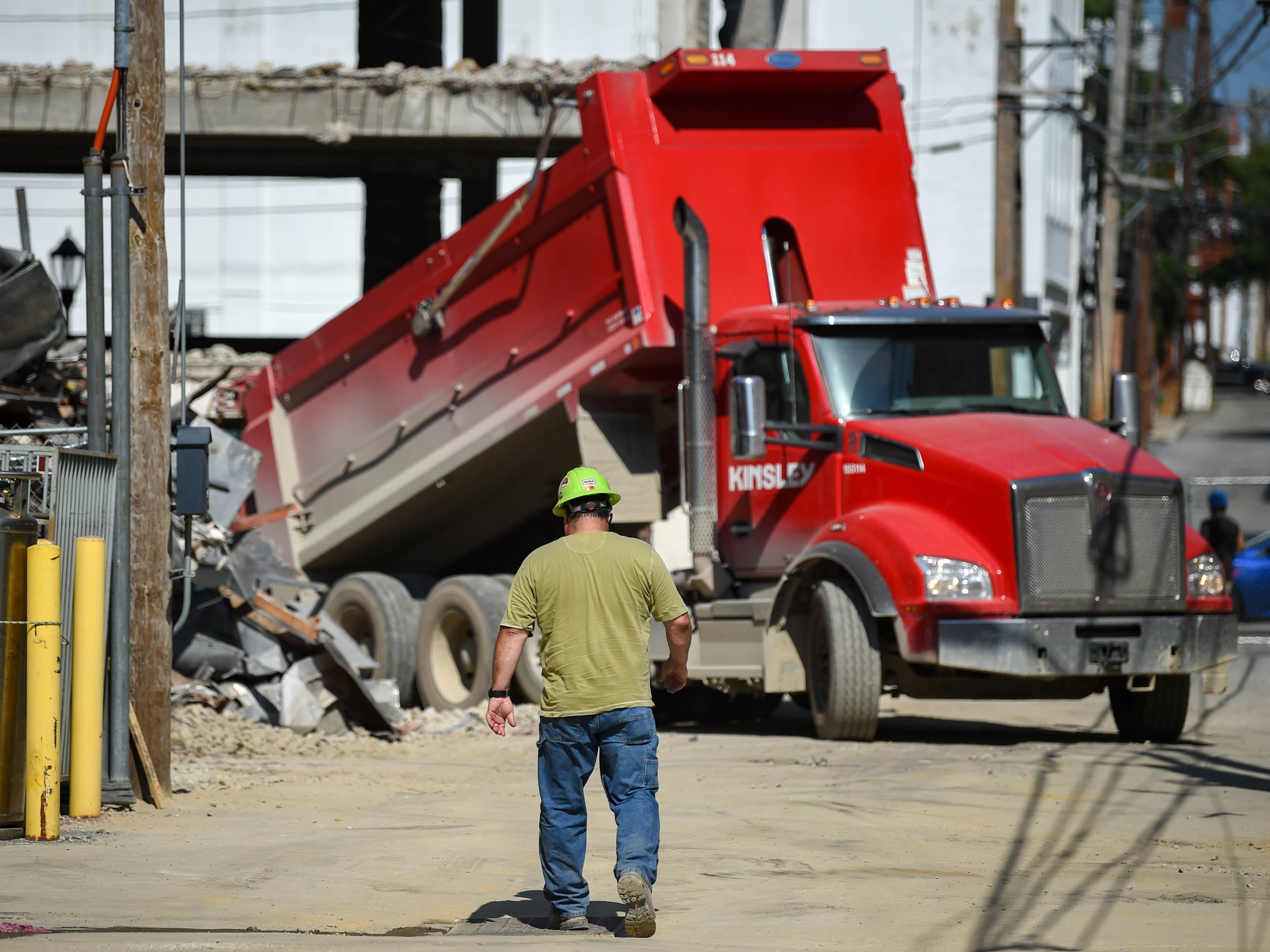 A dump truck drops its load at the Yorktowne Hotel on October 4, 2018.