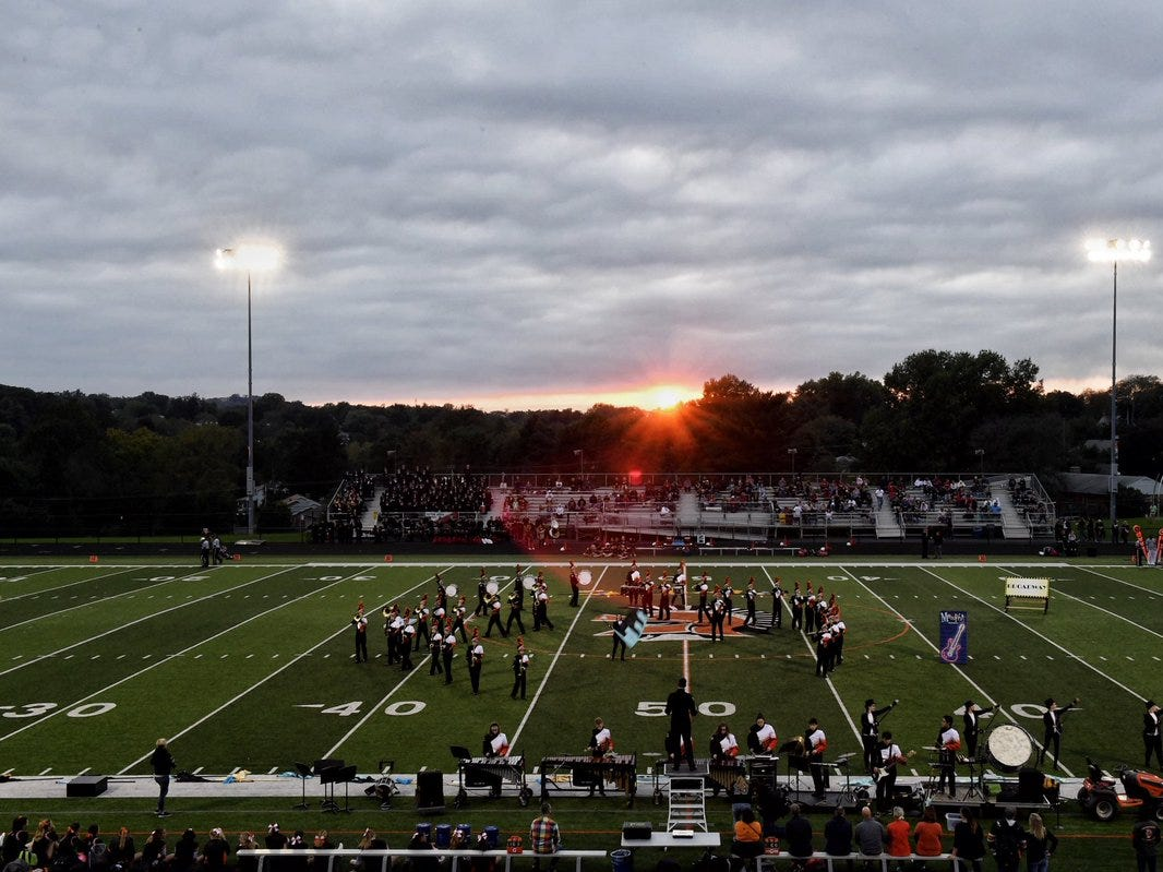 The sun sets on the York Suburban band before the YAIAA Game of the Week Friday against Dover.
