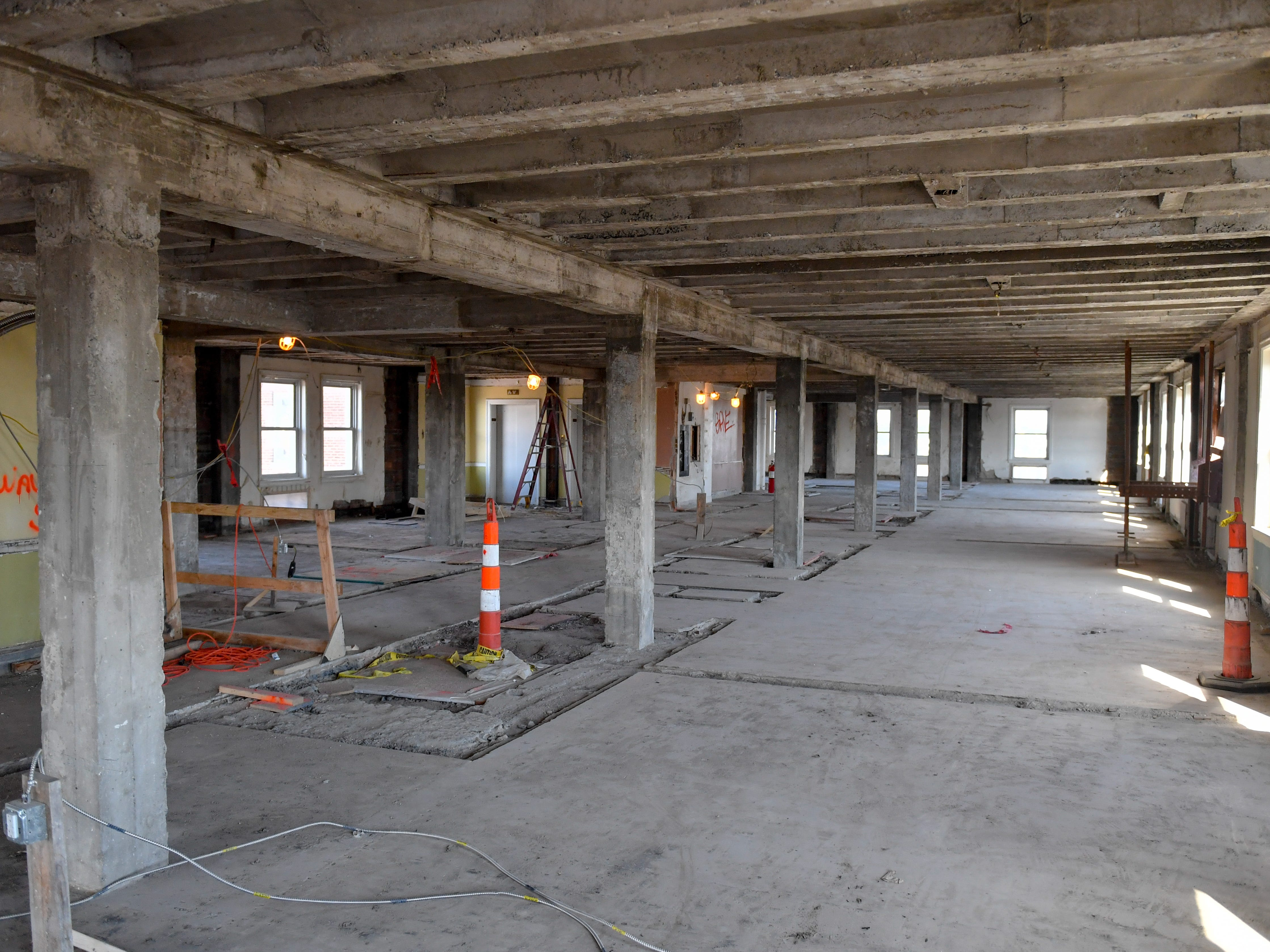 Construction workers come to the eight floor daily to continue taking apart the level at the Yorktowne Hotel on October 4, 2018.