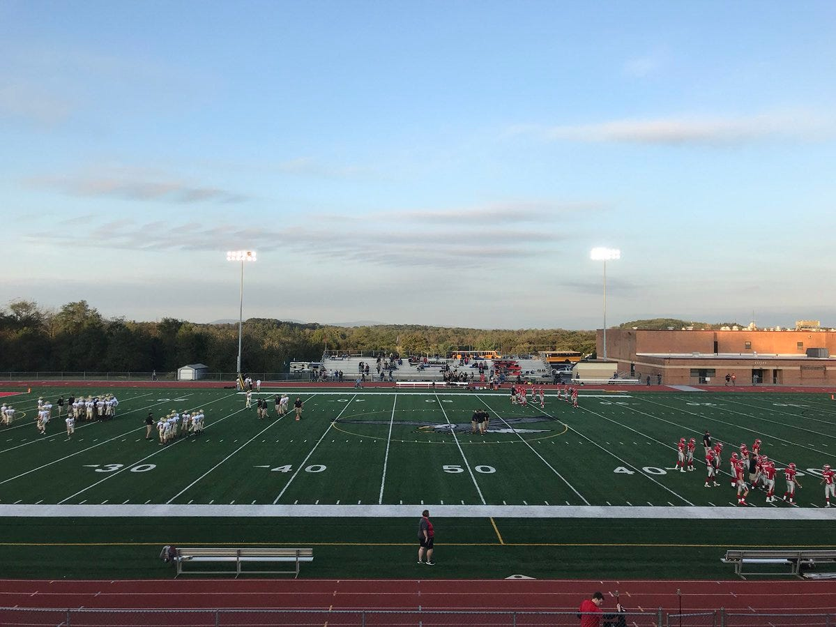 Delone Catholic and Bermudian Springs players warm up before Friday night's game.