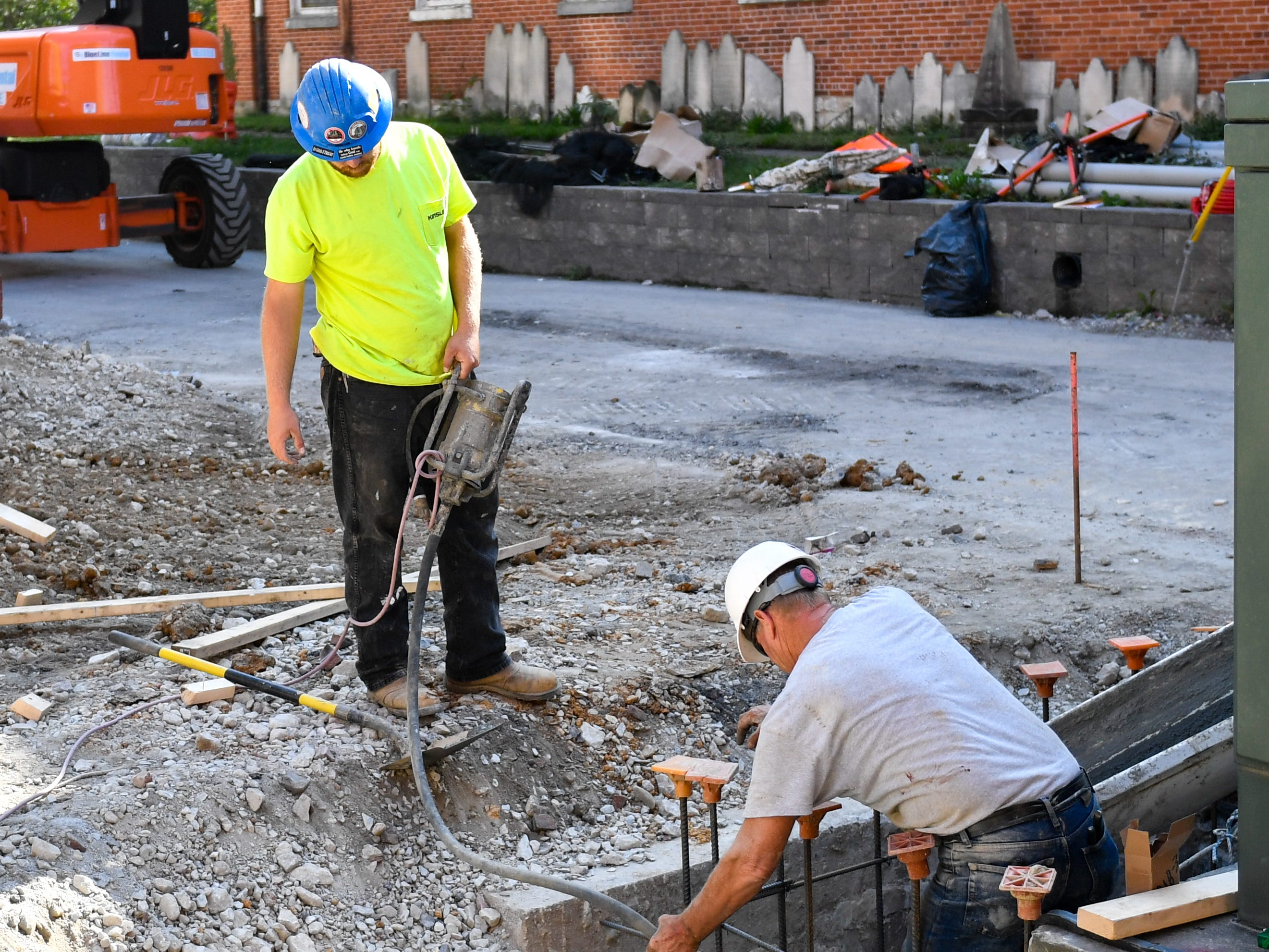 Construction workers lay down cement as part of the renovation process at the Yorktowne Hotel on October 4, 2018.