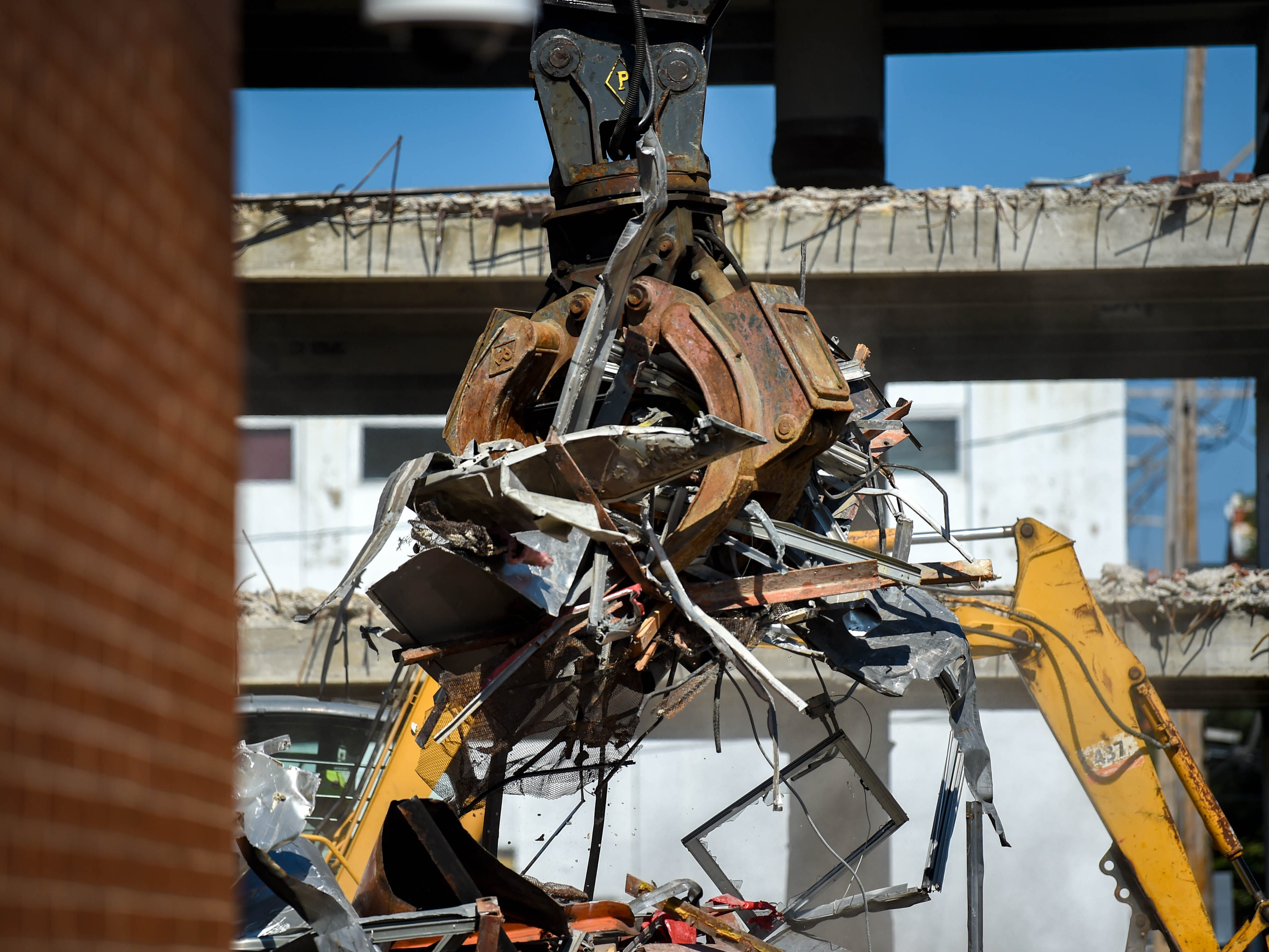 As the siding of the 1957 addition of the Yorktowne Hotel comes off, more debris is created on October 4, 2018.