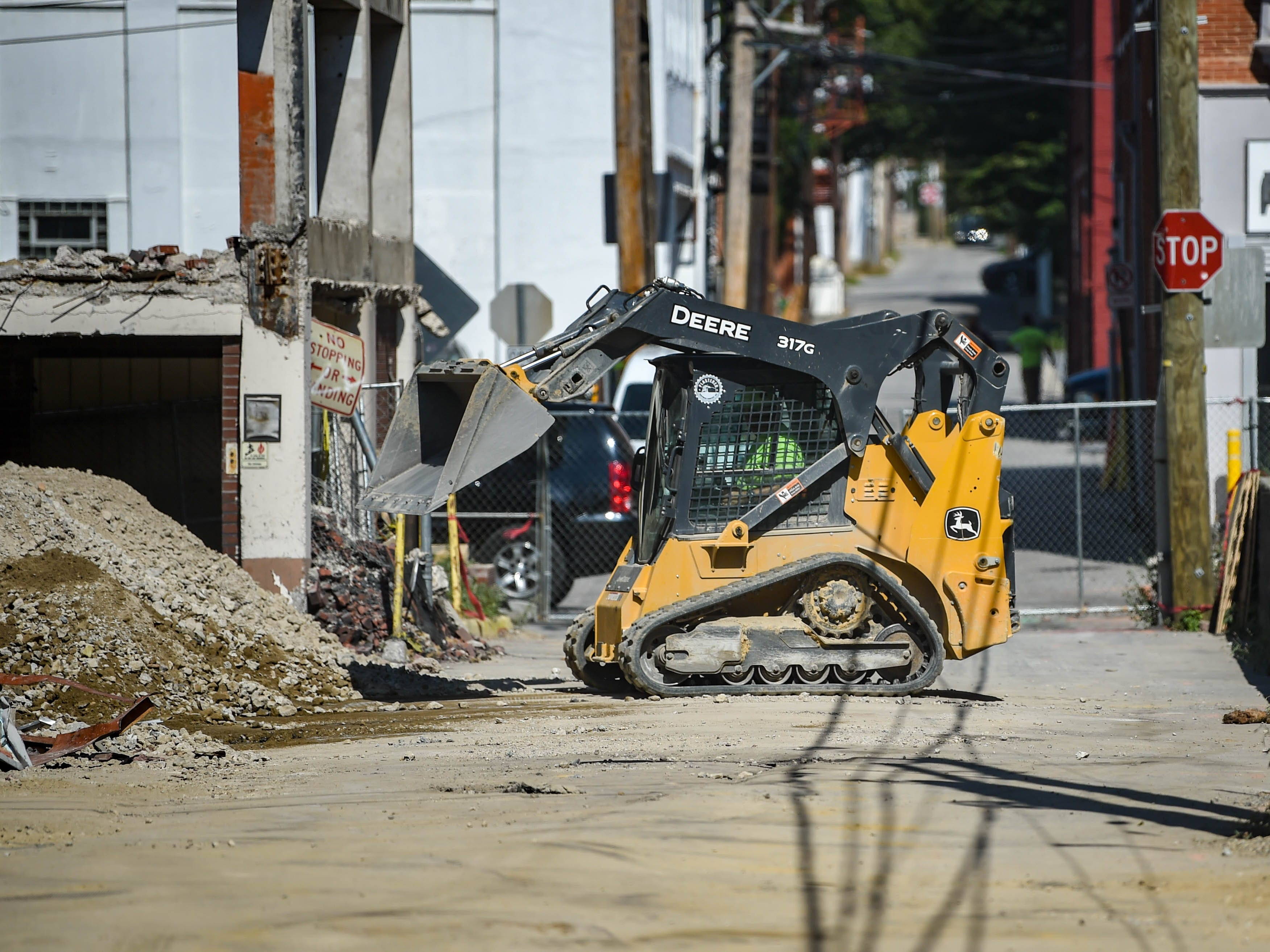 Construction workers make space for more vehicles to come through at the Yorktowne Hotel on October 4, 2018.