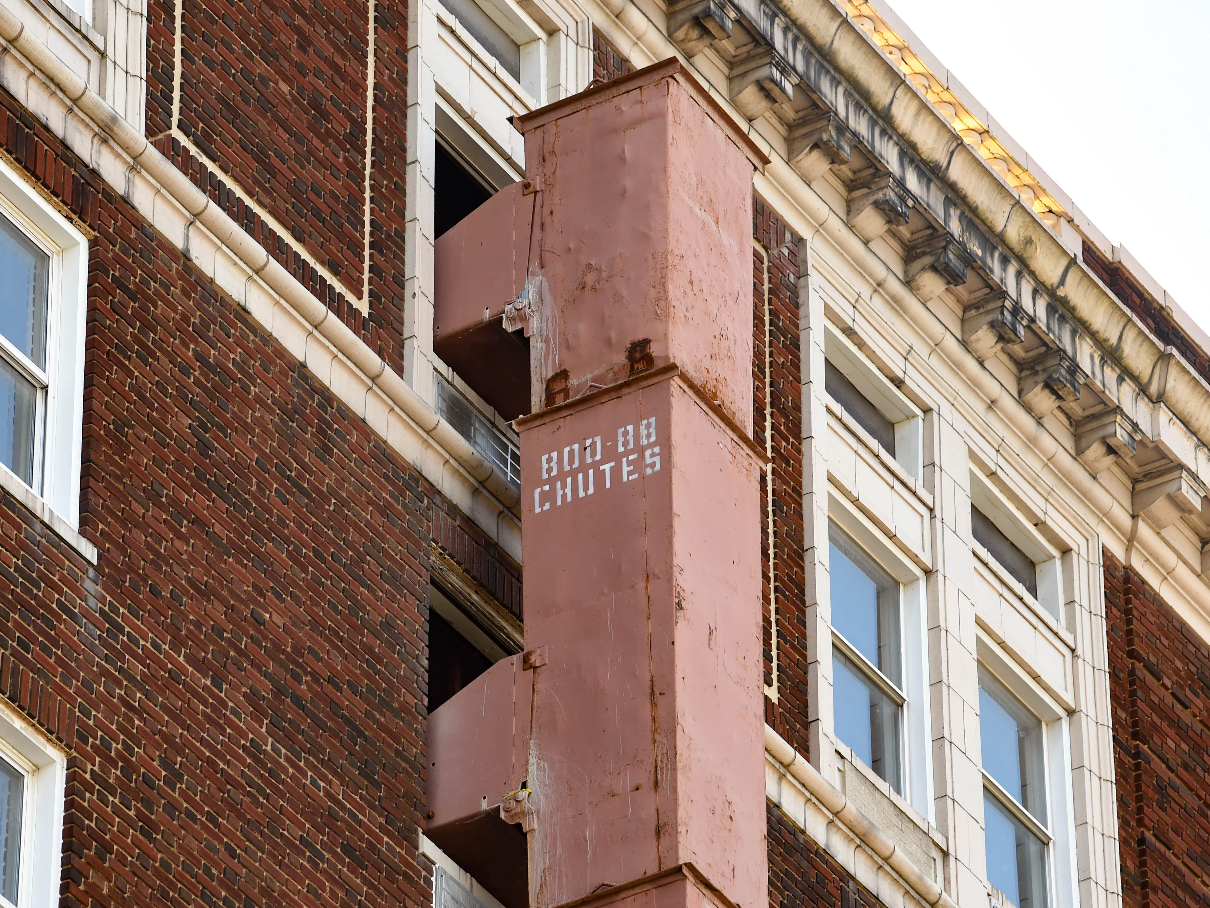 A garbage shoot is attached to the building to provide an easy dumping area for every floor being gutted at the Yorktowne Hotel on October 4, 2018.