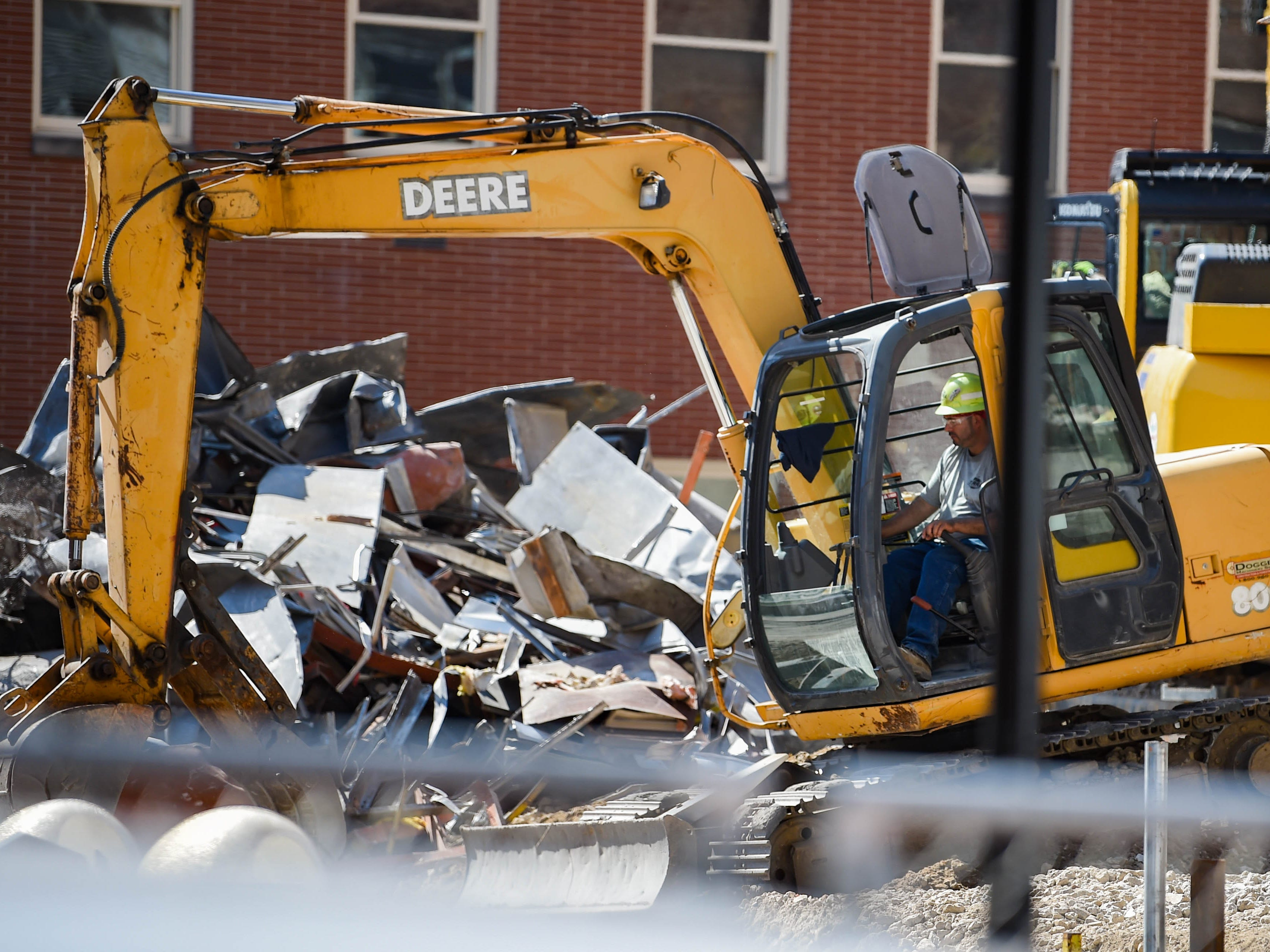 The trackhoe puts all debris in one area before putting on the back of a dump truck at the Yorktowne Hotel on October 4, 2018.