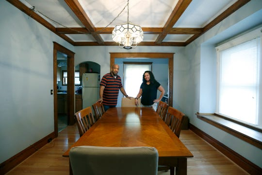 First-time home buyers Terrance Cooper and Lisa Rios-Bakari in their new home on Greeley Street.