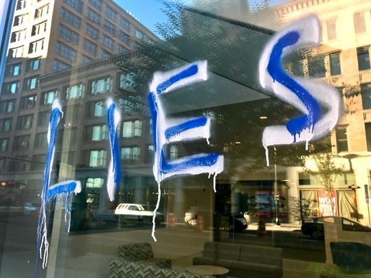 The windows of the Democrat and Chronicle offices in downtown Rochester were vandalized with graffiti.