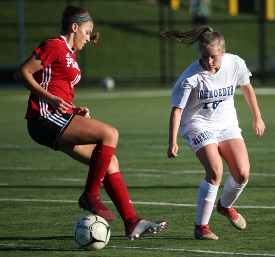 Penfiel's Rebecca Rolland looks to make a move during a regular-season match against Webster Schroeder. The Patriots and Warriors are the top two seeds in this fall's Section V Class AA Tournament.