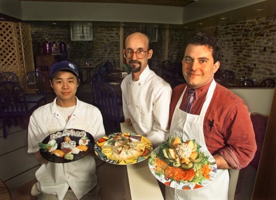 March 2, 1998: Owner Christian Wandtke (right), Chef Al Horr and Sushi Chef Mei Xing Zheng (left) hold a variety of entrees offered at Wandtke's Old City Hall Restaurant and Humidor Club.