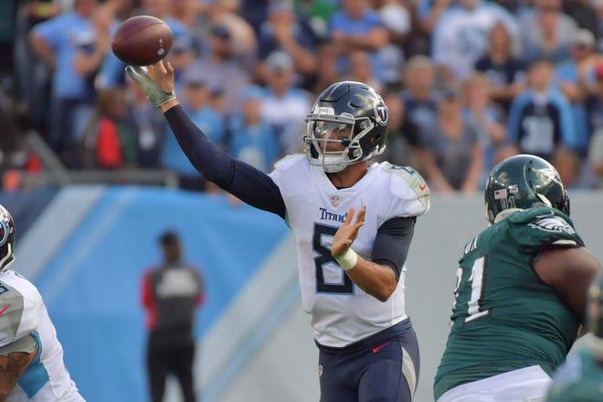 Tennessee Titans quarterback Marcus Mariota (8) passes against the Philadelphia Eagles during overtime at Nissan Stadium.
