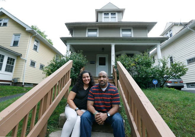 First-time home buyers Lisa Rios-Bakari and Terrance Cooper on Greeley Street.