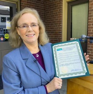 Redding Mayor Kristen Schreder holds her proclamation commemorating the city's anniversary of incorporation. Schreder and others celebrated Redding's 131st birthday Thursday in front of Old City Hall.