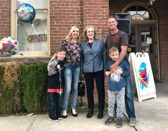 Redding Mayor Kristen Schreder, center,  poses with Danit and Kasey Dollar of Redding and their two children. Jaden, left, turned 8 on Thursday while the city of Redding turned 131.