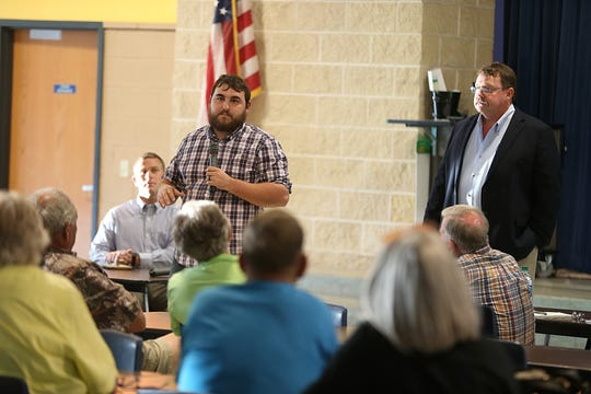 Clint Hudson, vice president of San Angelo Friends of the Environment, (left) speaks at a public town hall meeting Thursday, Oct. 4, 2018, about the City's recycling program at Lincoln Middle School.