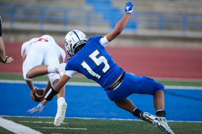 Lake View's Johnny Espinosa attempts to tackle as Brownfield ball carrier leaps past him for a touchdown Thursday, Oct. 4, 2018, at San Angelo Stadium.