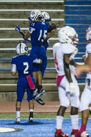 Lake View players celebrate a touchdown against Brownfield Thursday, Oct. 4, 2018, at San Angelo Stadium.