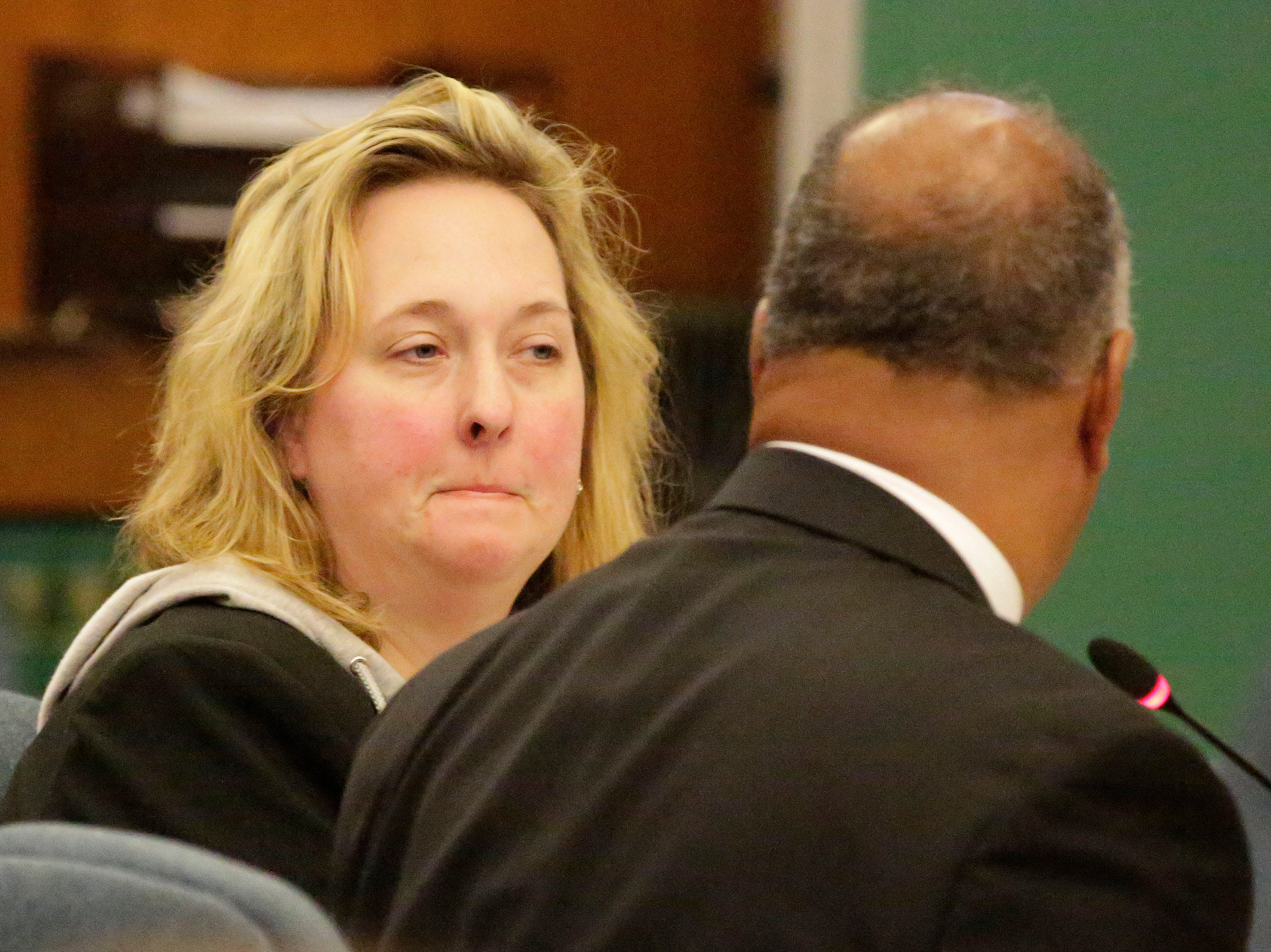 Former Kinship Companions owner Christy Rose Tuchel, left, purses her lips as she sits next to her attorney, Gary George, in Sheboygan County Circuit Court Branch 1 during her sentencing hearing, Friday, October 5, 2018, in Sheboygan, Wis. Tuchel received a 1 year jail sentence and 8 years of probation.