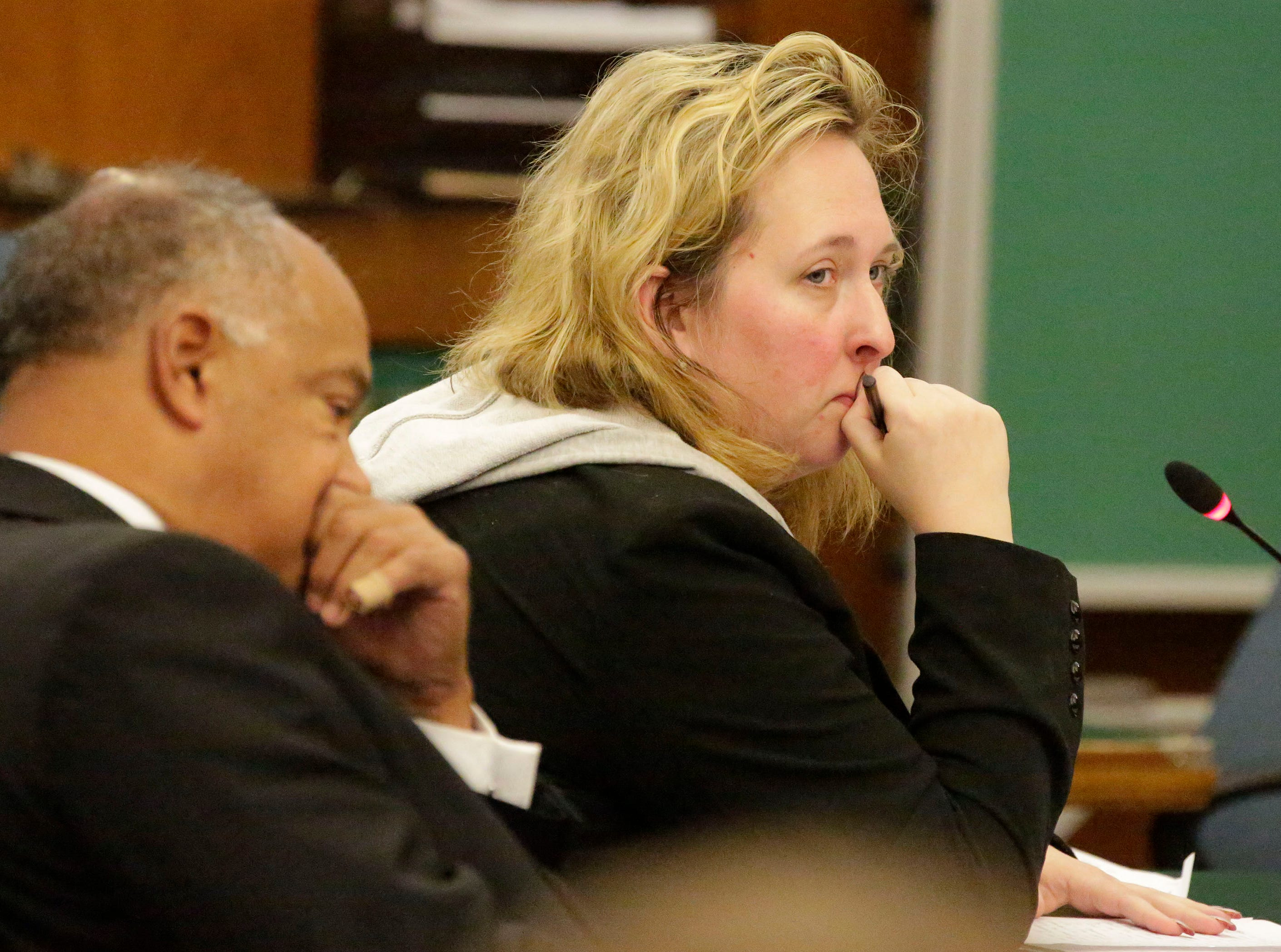 Former Kinship Companions owner Christy Rose Tuchel, right, sits next to her attorney, Gary George, in Sheboygan County Circuit Court Branch 1 during her sentencing hearing, Friday, October 5, 2018, in Sheboygan, Wis.  Tuchel received a 1 year jail sentence and 8 years of probation.