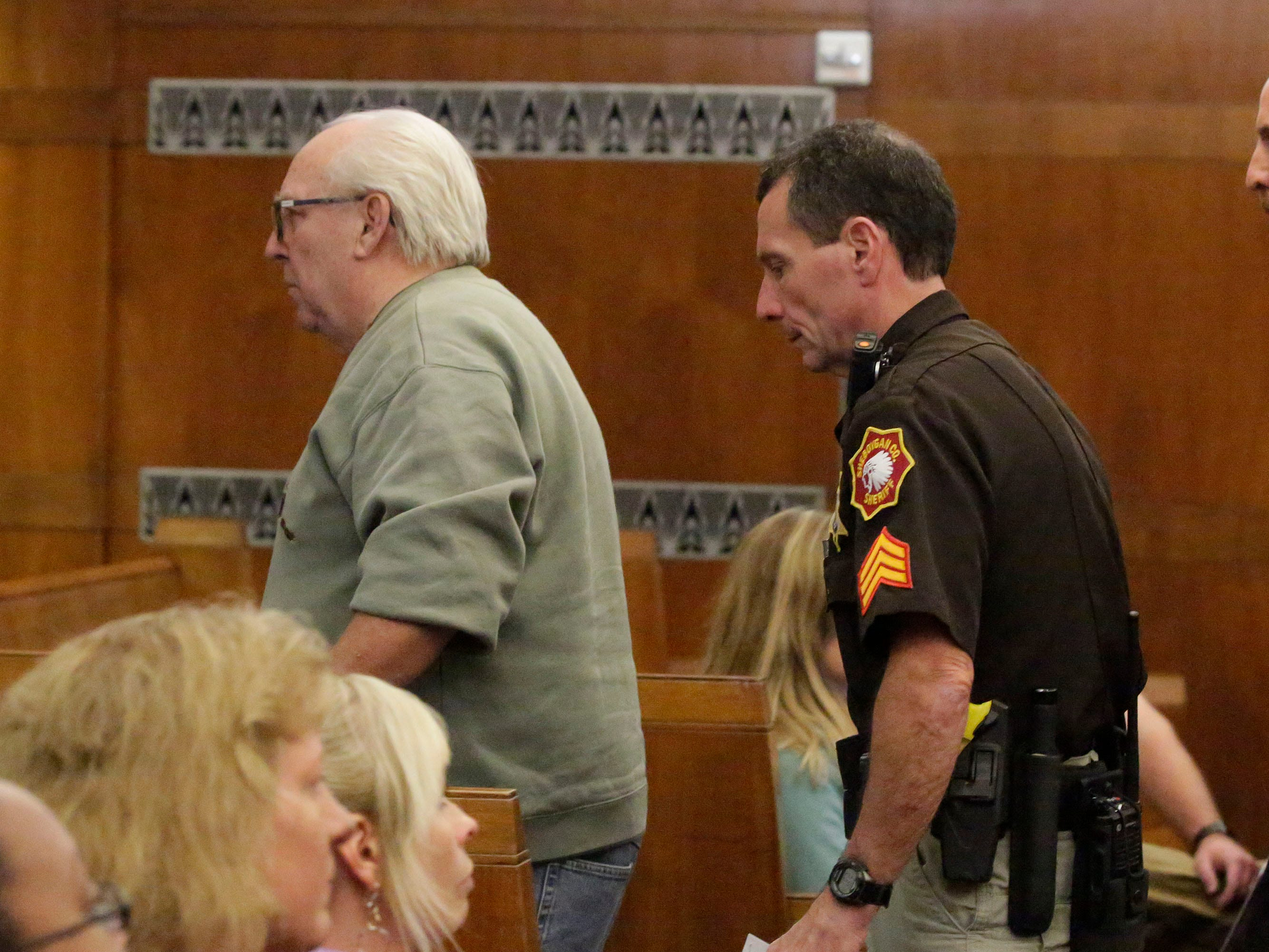 Theodore Tuchel, left, exits Sheboygan County Court Branch 1, Friday, October 5, 2018, in Sheboygan, Wis.  Tuchel was ejected from the courtroom by Stengel.  Tuchel was speaking on behalf of his daughter Christy Rose Tuchel, who ran Kinship Companions kennel where dead dogs were discovered in an unplugged freezer.