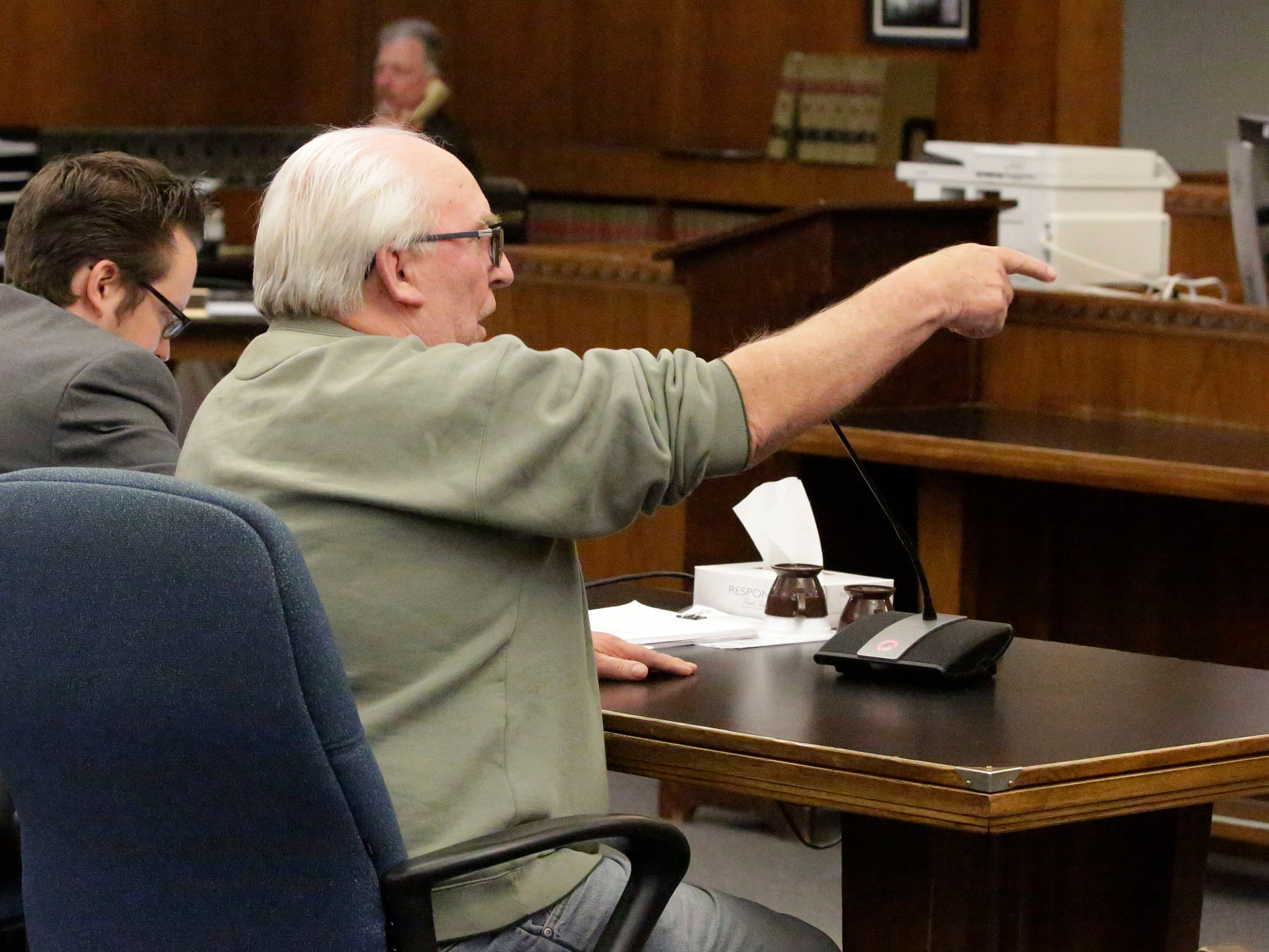 Theodore Tuchel points at Judge L. Edward Stengel while Tuchel gave his impact statement in Sheboygan County Court Branch 1, Friday, October 5, 2018, in Sheboygan, Wis.  Tuchel was ejected from the courtroom by Stengel.  Tuchel was speaking on behalf of his daughter Christy Rose Tuchel, who ran Kinship Companions kennel where dead dogs were discovered in an unplugged freezer.