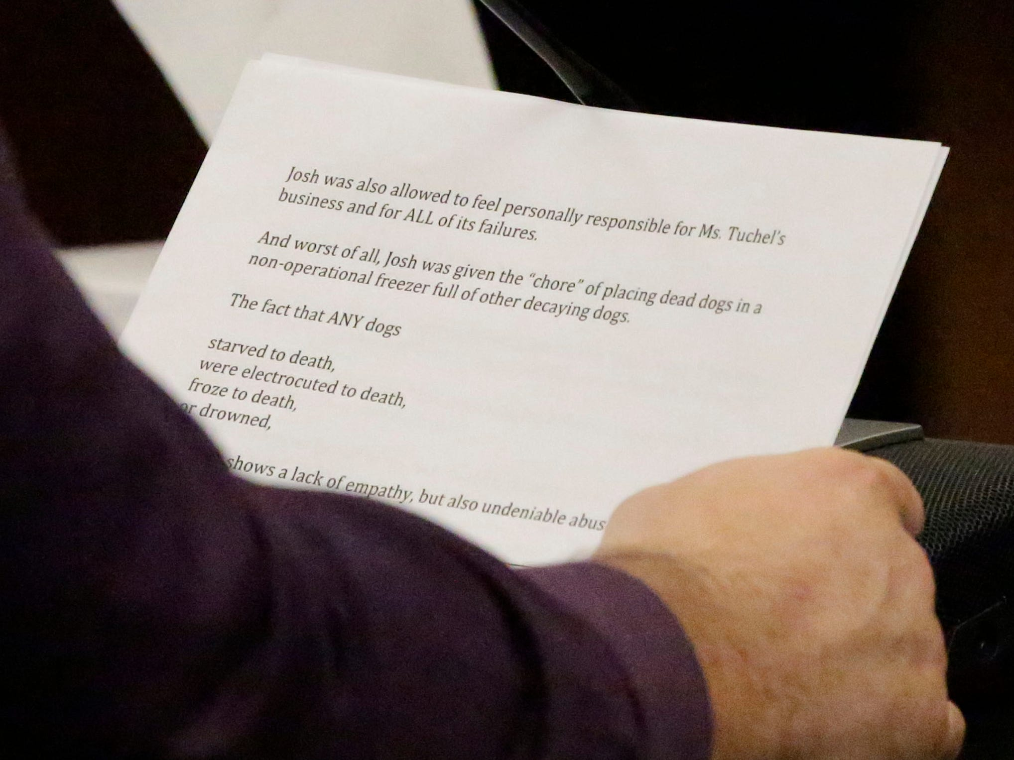 A tight shot of a page of the impact statement that Charles Mikula read into the court record in Sheboygan County Circuit Court Branch 1, Friday, October 5, 2018, in Sheboygan, Wis. Mikula's ex-wife Christy Rose Tuchel, is being sentenced in her involvement in the deaths of dogs at the former Kinship Companions kennel.