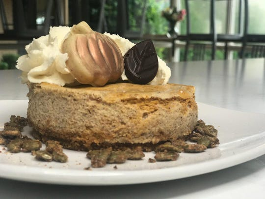 Whisk Dessert Bar's pumpkin cheesecake has a spice crumb base, coffee infused whipped cream, espresso pepitas, pumpkin spice white chocolate bonbon and  a mocha dark chocolate bonbon.