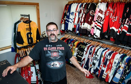 Heath Warnert, Sartell, talks about the hockey jerseys Wednesday, Oct. 3, in his massive collection