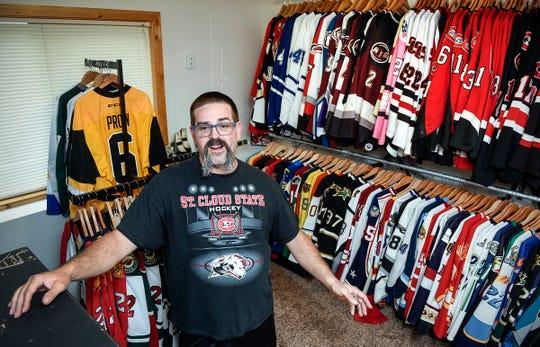 Heath Warnert, Sartell, talks about the hockey jerseys Wednesday, Oct. 3, in his massive collection