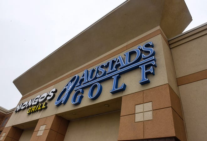 A sign marks the new location of Austad's Golf Friday, Oct. 5, in St. Cloud.