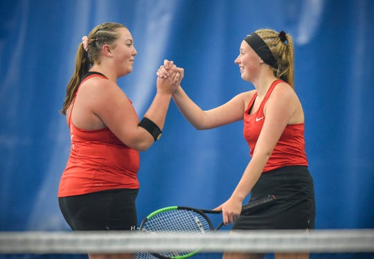 ROCORI's Amanda Molitor and Megan Kalthoff celebrate a point during the number one doubles match Thursday, Oct. 4, in South Subsection 8-2A action at STa-FIT in Sartell.