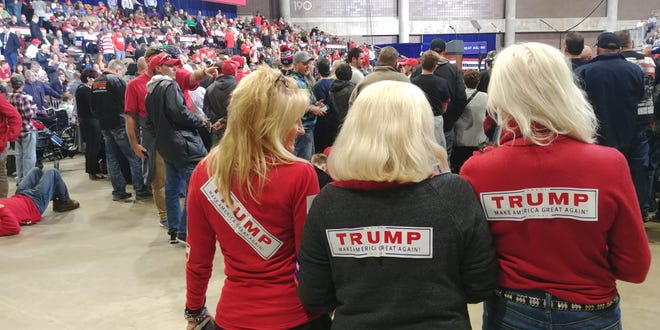 Melissa Moore (left) is running for Minnesota house out of St. Louis Park. She was covered in campagn stickers at the Trump rally at the Rochester Mayo Civic Center on Thursday, Oct. 4,, along with Michele Northey of Bloomington and Kathy Wood of St. Paul.