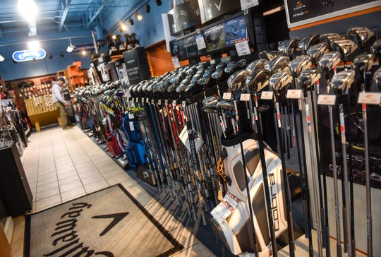 Many brands and styles of golf clubs are on display at Austad's Golf Friday, Oct. 5, in St. Cloud. The business will be moving to a new space near the current store location.