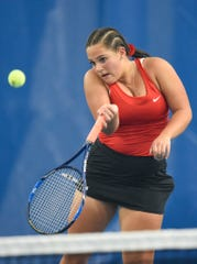 ROCORI's Grace Schneider returns the ball to Willmar's Lydia Morrell during the number one singles match Thursday, Oct. 4, at STa-FIT in Sartell.