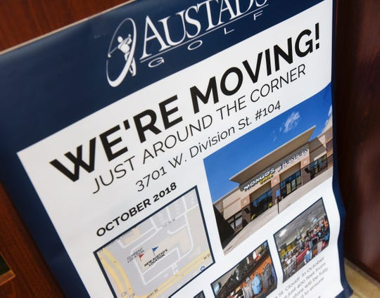 A sign announces the coming move of Austad's Golf in St. Cloud.