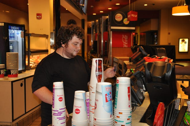 Walker Bullington works at the AMC Theatres in Tallahassee as an usher.