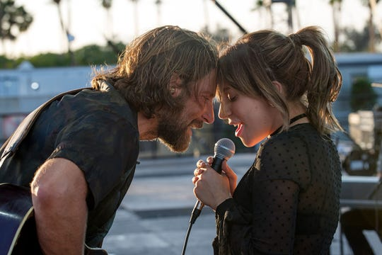 "Bradley Cooper, left, and Lady Gaga star in the latest retelling of ""A Star is Born."" It's almost good."