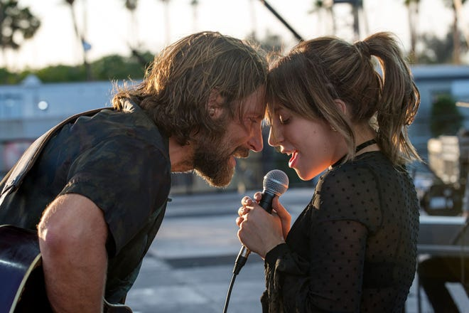 """Bradley Cooper, left, and Lady Gaga star in the latest retelling of """"A Star is Born."""" It's almost good."""