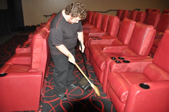 Walker Bullington, who works at AMC Theatre, receives services from the Agency for Persons with Disabilities.