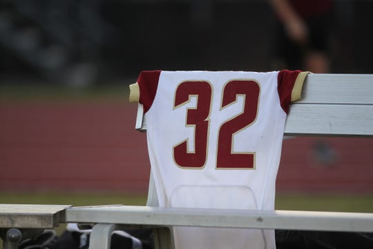 The late Cam Brown's jersey sits on the Florida High bench during pregame for NFC at Florida High, high school football, Oct. 5, 2018.