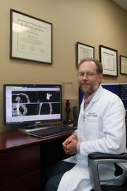 Capital Regional Cancer Center Radiation Oncologist Tim Bolek demonstrates the dosimetry software used in creating treatment plans for cancer patients Friday, Oct. 5, 2018 in Tallahassee, Fla. The program allows the staff to carefully calculate the dose and location of radiation that goes into the body during treatment.