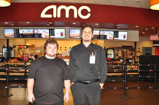 Walker Bullington with Jose Ramirez at the AMC Theater where he works.