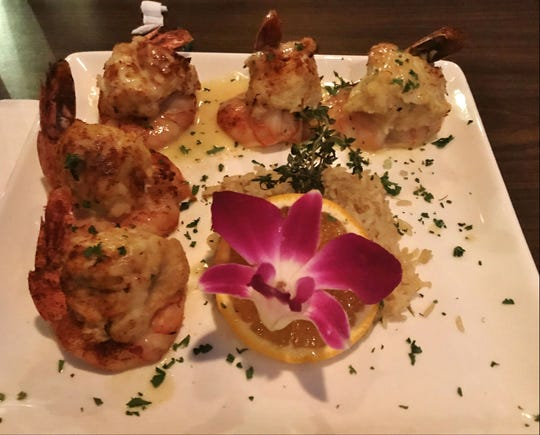 12A Buoy's Crab Stuffed Shrimp is a generous portion of large, tender shrimp loaded with lump crab meat then broiled and topped with a citrus beurre blanc sauce.