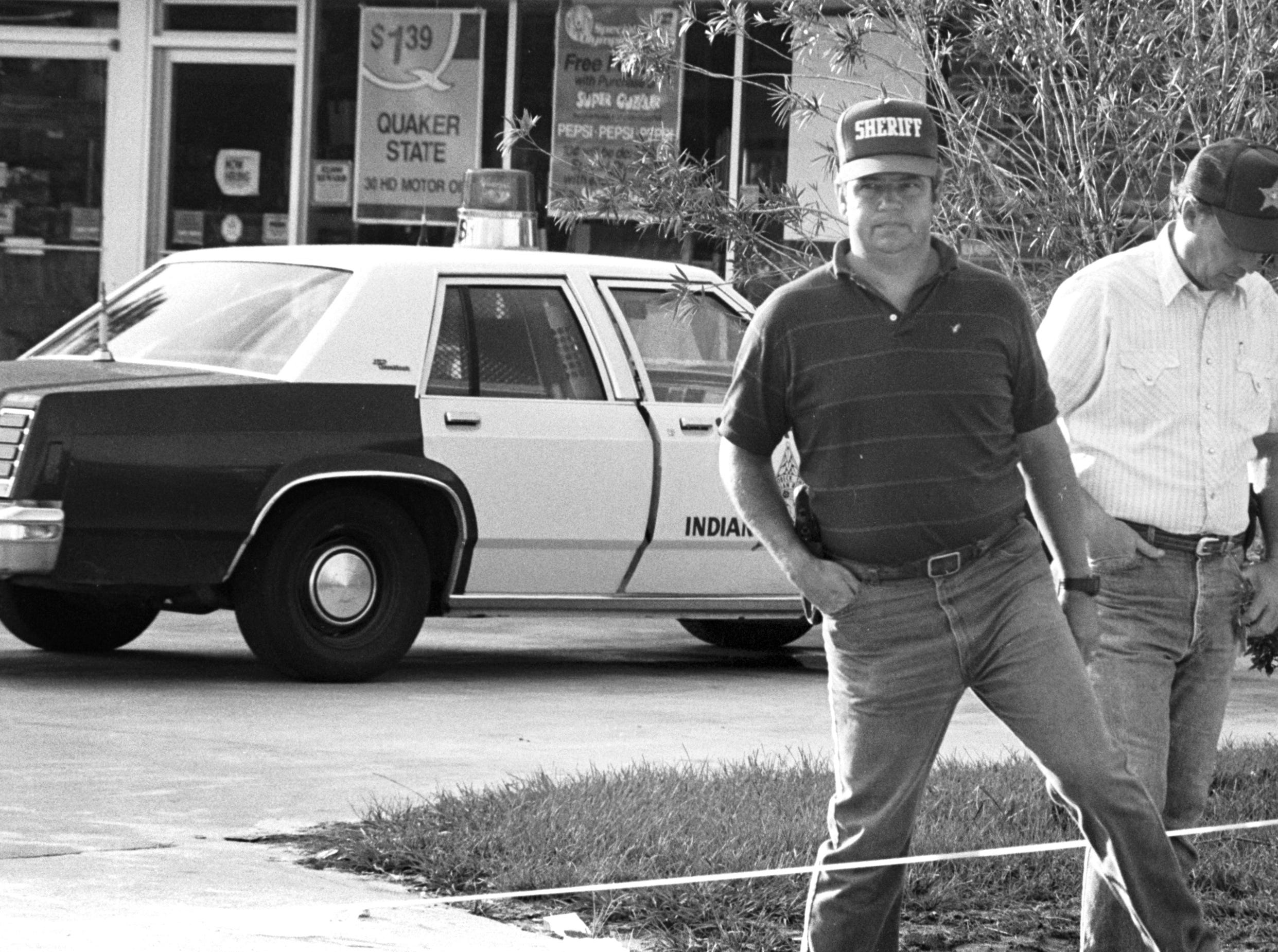 Indian River County Sheriff Tim Dobeck (left) and Undersheriff Roy Raymond were seen at Zippy Mart, 82nd Avenue at State Road 60, where on Sept. 23, 1986, an early morning shooting killed Deputy Richard Raczkoski, 29. He was shot to death by William Reaves, a Vietnam veteran and ex-convict. Reaves was convicted and sentenced to Florida's Death Row.