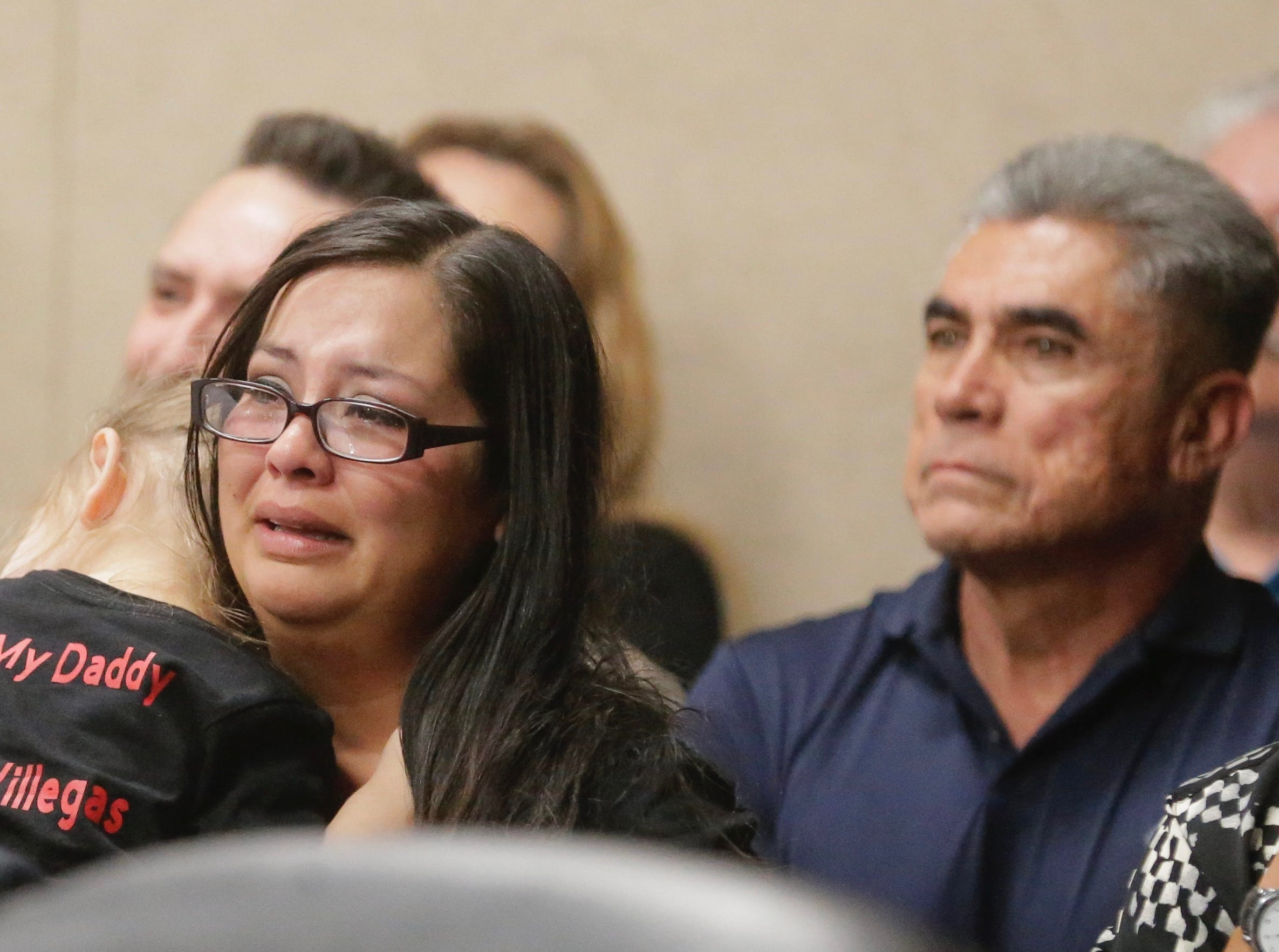 Daniel Villegas' wife, Amanda, holds their daughter and cries as the verdict is read in his third trial for capital murder. The not guilty verdict ends a 25-year-long saga.
